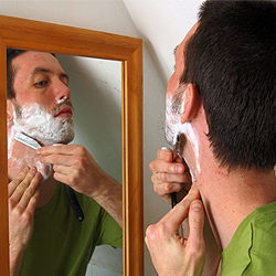 how to stop a shaving cut from bleeding on lip