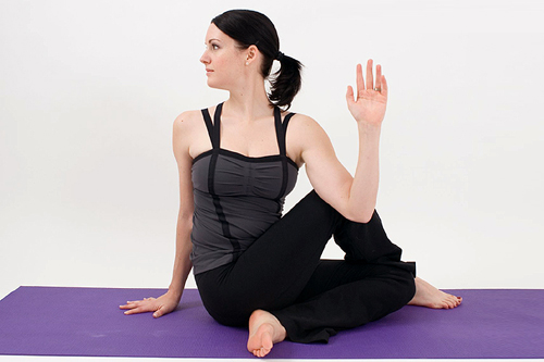 Half Spinal Twist While Sitting Pose