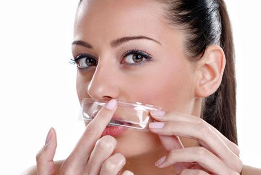 woman waxing her upper lip hair