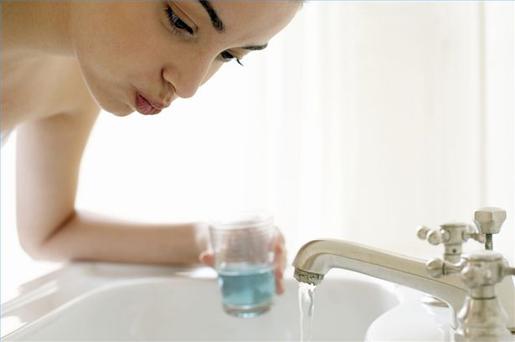 Gargling with antiseptic mouthwash