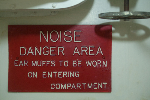 Ear muffs sign - warning of engine noise