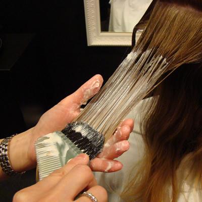applying hair straightening cream