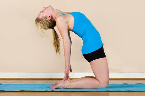 Camel Pose is backbending pose performed in Moksha yoga