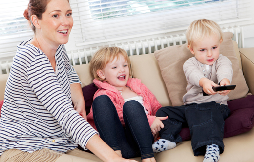 mom watching tv with kids