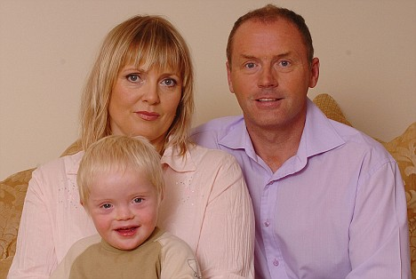 Couple with their son who having Down's Syndrome