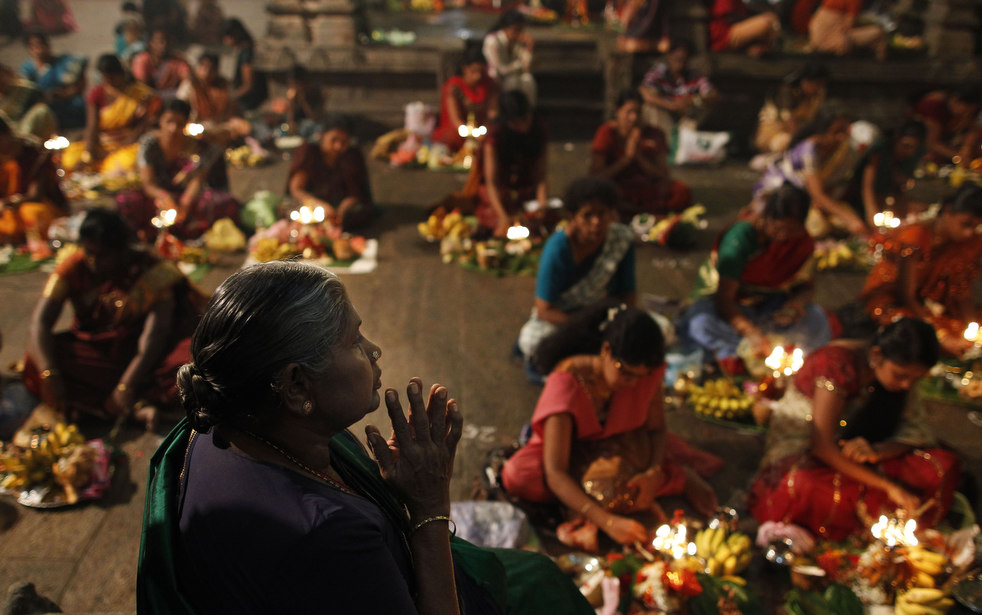 Hindu devotees participate in religious ritual celebrating Diwali festival